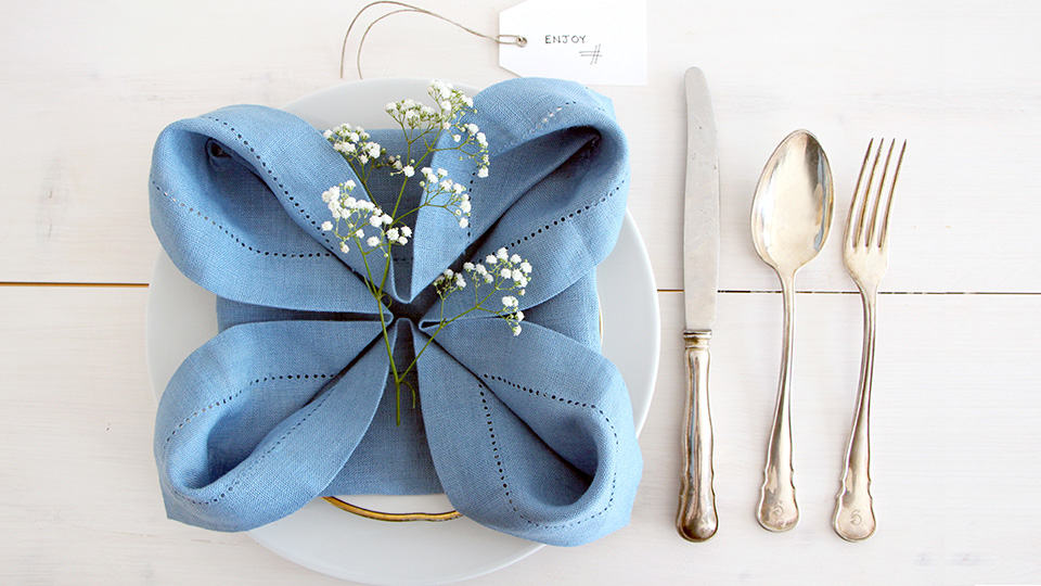 Rose napkin fold adds special touch to any table lakes region tent flower napkin fold mightylinksfo